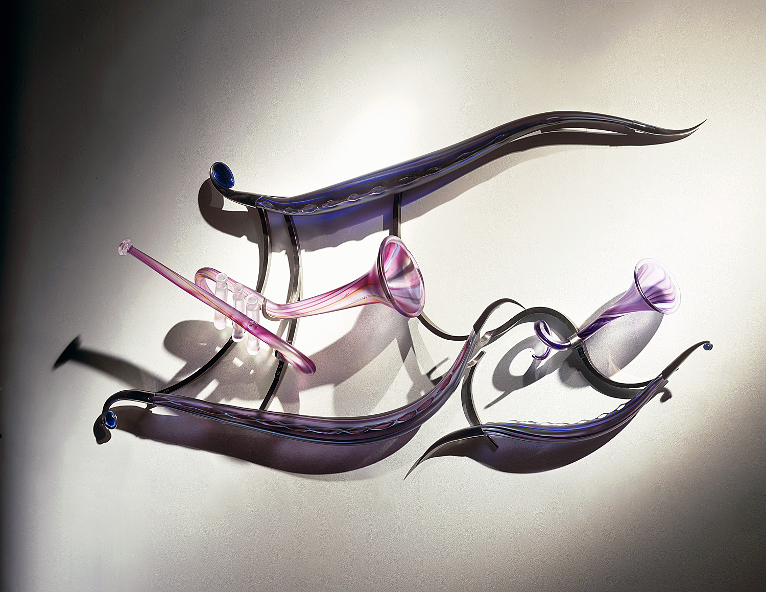 Night in Tunisia   2003. Blown glass, glass details, nickel-plated bronze. 26 x 56 x 8""