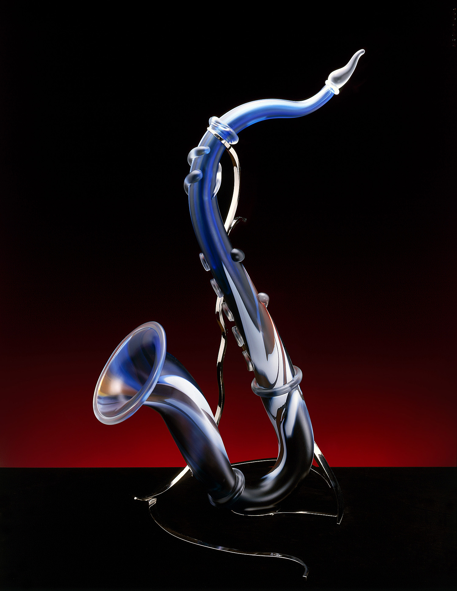 Synthesis   2002. Blown glass, glass details, nickel-plated bronze. 28 x 13 x 20""