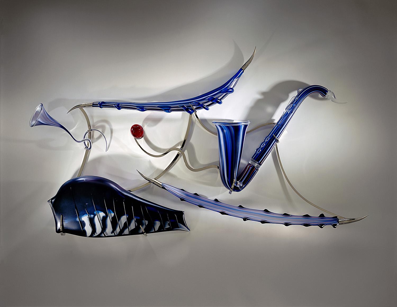 "Sum Sum   2002. Blown glass, glass details, nickel-plated bronze. 33 x 55½ x 7½"""