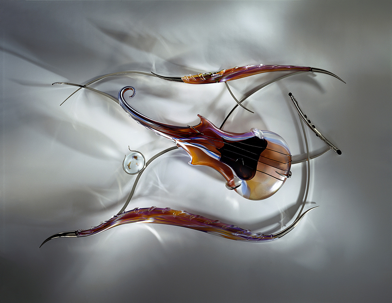 Body and Soul   2001. Blown glass, glass details, nickel-plated bronze. 32 x 51 x 5½""