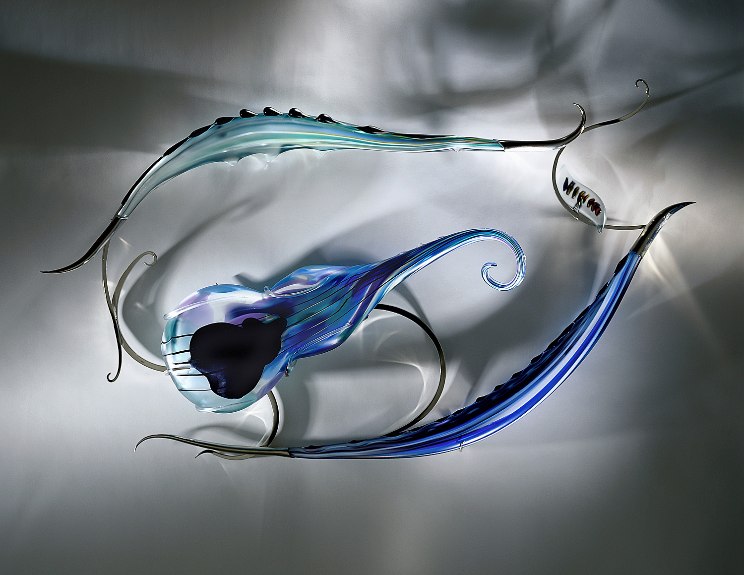 Four on Six   2001. Blown glass, glass details, nickel-plated bronze. 32 x 51 x 6½""