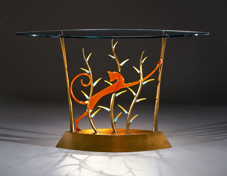 "Ratteau's Puma   2000. Cast bronze, pate de verre, plate glass. 36 x 64 x 21"""