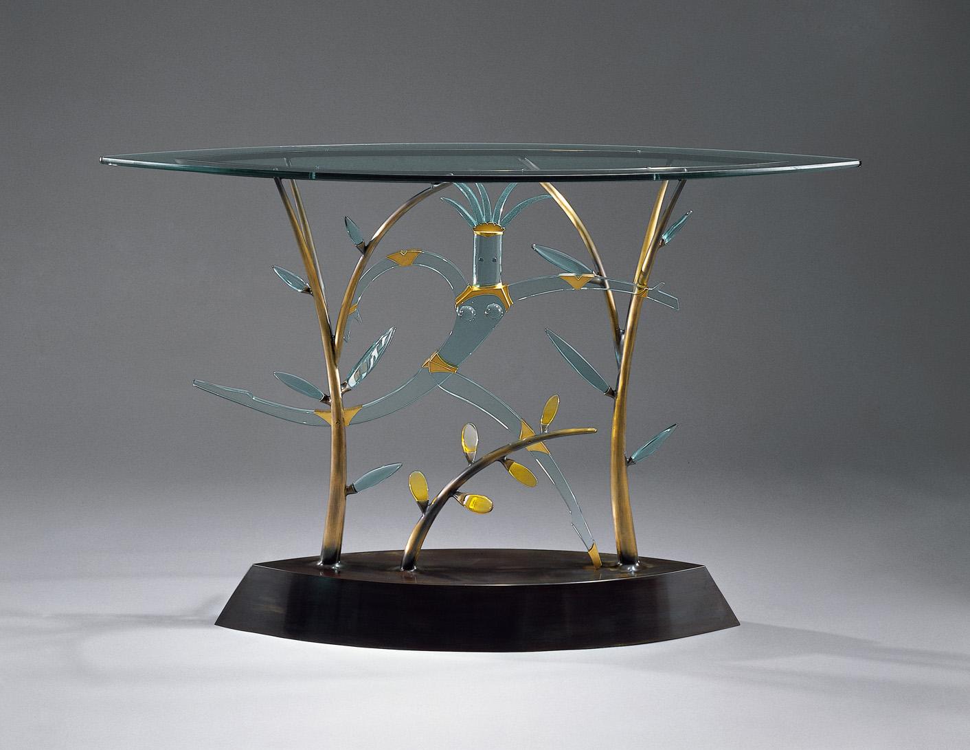 "Nude Running   1999. Plate glass, cast bronze, gold-plated bronze. 37 x 57 x 18"""