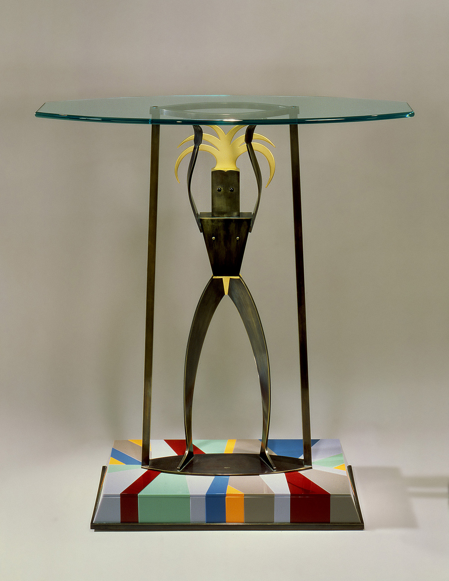 "Warrior Table   1992. Bronze, gold-plated bronze, Vitrolite. 38 x 12 x 25"""