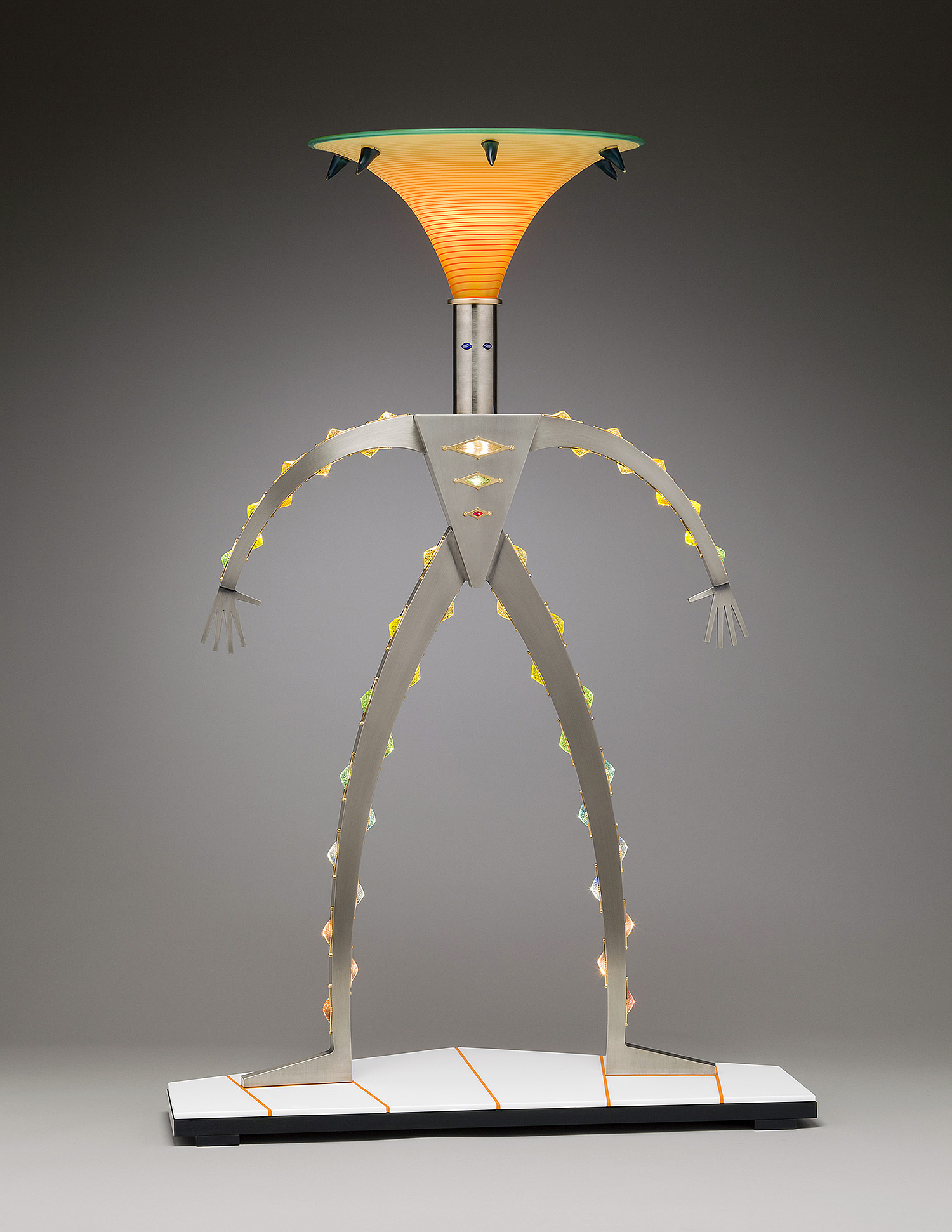 """Suit of Light   2011. Blown glass, nickel-plated and anodized aluminum, gold plated brass, 50 LED lights, pate de verre and Vitrolite glass. 48 x 36 x 17"""""""