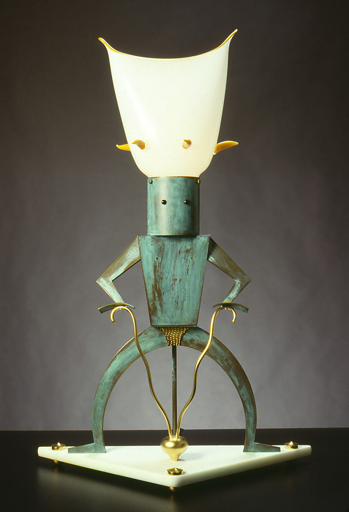"""The Scientist   1990. Blown glass, bronze, gold-plated bronze, Vitrolite and lampworked glass. 34½ x 23 x 9"""""""