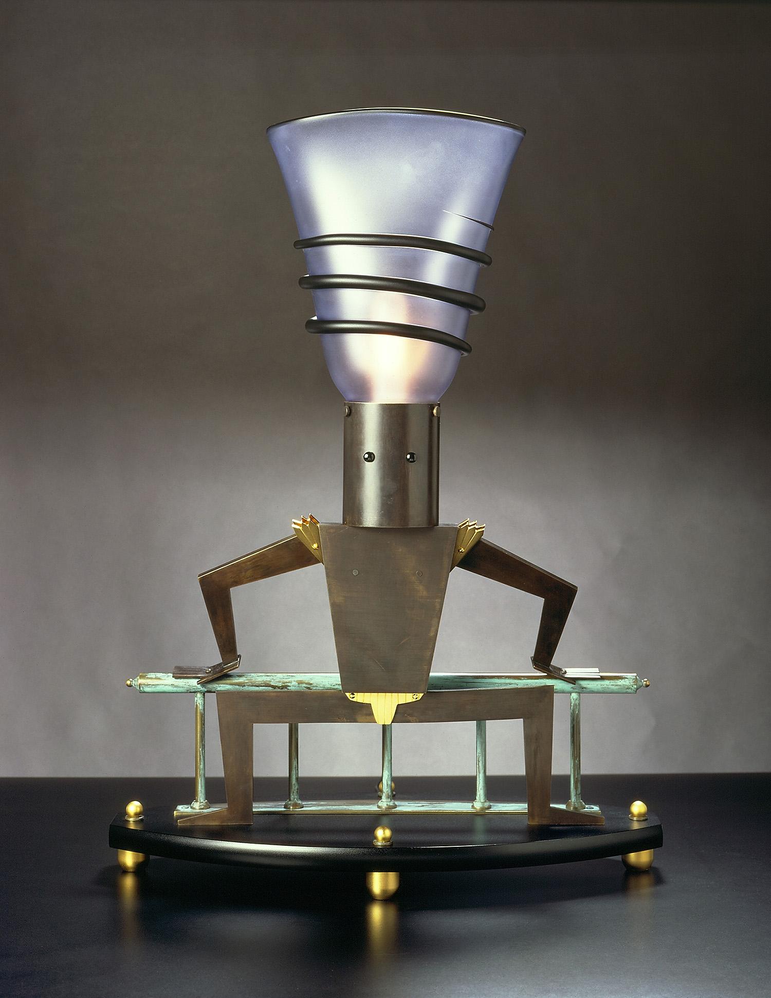 "Balustrade Man   1990. Blown glass, bronze, gold-plated bronze, Vitrolite and lampworked glass. 27¼ x 20 x 10"""