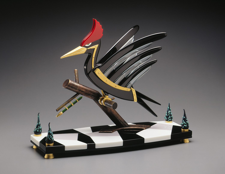 "Woodpecker   1995. Glass, Vitrolite, bronze, gold-plated bronze. 18 x 22 x 8"""