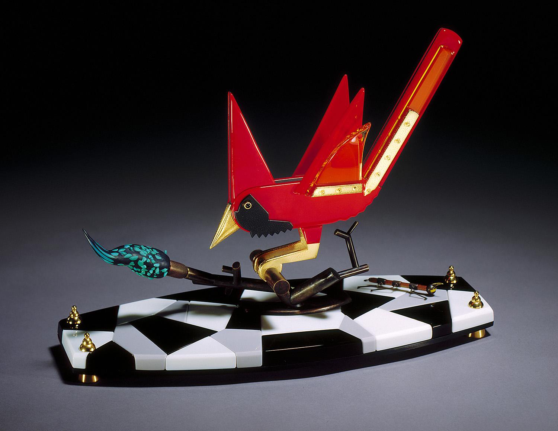 "Cardinal   1995. Vitrolite, blown glass, aluminum, bronze. 14½ x 20 x 8"""
