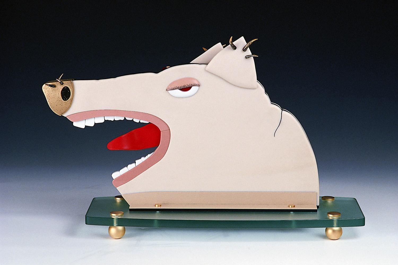 "Hog   1984. Vitrolite, plate glass, gold-plated brass, enamel. 17 x 24½ x 10"""