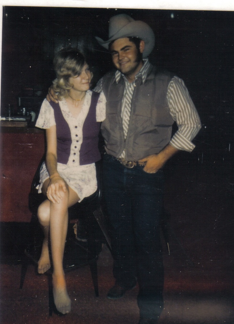 My favorite picture of my parents. This was taken in the bar where they met. Probably about 1974. I've always wondered why mom doesn't have on any shoes. Must have been quite an evening.