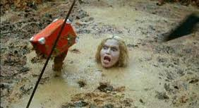 Tragedy strikes as the best character in the movie dies while trying to save her make-up case.