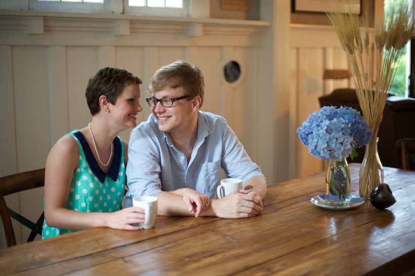 Photo by Elizabeth Glessner of Glessner Photography of artist Adam Trest and high school teacher Lily Hedgepeth's engagement session in their dining room at their historic home in downtown Laurel, Mississippi