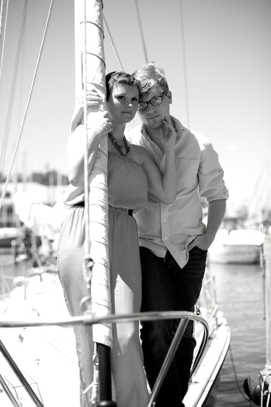 Black and white photo by Elizabeth Glessner of Glessner Photography of artist Adam Trest and high school teacher Lily Hedgepeth's sailboat engagement session in Fairhope, AL