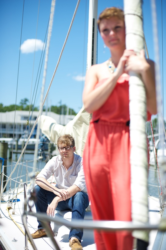Photo by Elizabeth Glessner of Glessner Photography of artist Adam Trest and high school teacher Lily Hedgepeth's sailboat engagement session in Fairhope, AL