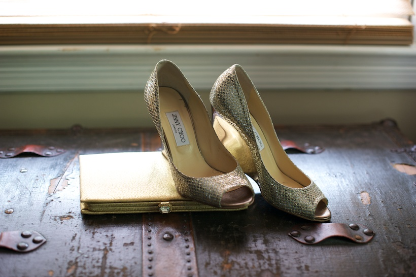 Photo by Elizabeth Glessner of Glessner Photography of gold clutch and silver and gold Jimmy Choo platform peep toe wedges at the backyard wedding of J.P. Perkins and Katherine Henry in Asheboro, NC