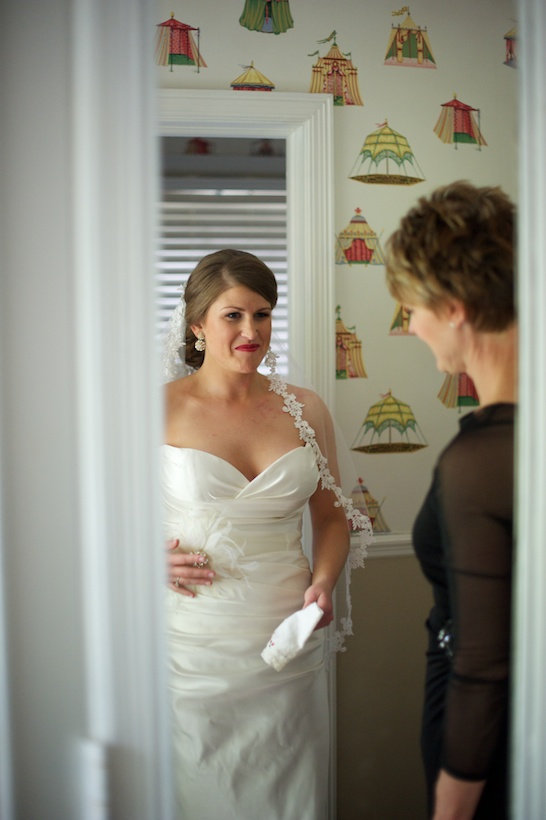 Wedding day getting ready photo by Elizabeth Glessner of Glessner Photography of the bride looking in the mirror at her Jenny Lee wedding gown from Carine's Bridal in Washington DC at the backyard wedding of J.P. Perkins and Katherine Henry in Asheboro, NC