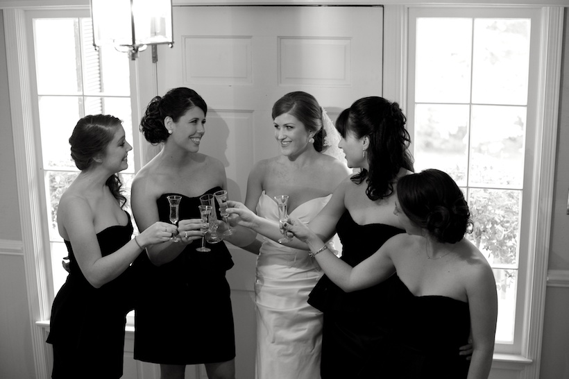 Wedding day photo by Elizabeth Glessner of Glessner Photography of the bride and bridesmaids champagne toast at the backyard wedding of J.P. Perkins and Katherine Henry in Asheboro, NC