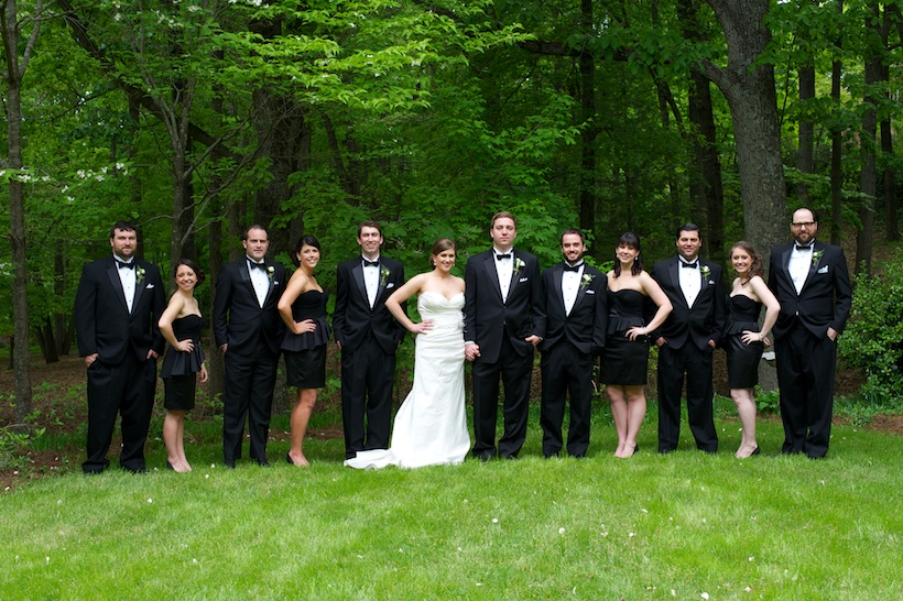 Bridal party photo by Elizabeth Glessner of Glessner Photography of the groom and groomsmen in Joseph A. Bank, bridesmaids in a black Karen Millen cocktail dress, and the bride wearing a Jenny Lee wedding dress from Carine's Bridal in Washington DC and a vintage cathedral veil with hair and makeup by Carla White of Greensboro at the spring backyard wedding of J.P. Perkins and Katherine Henry in Asheboro, NC