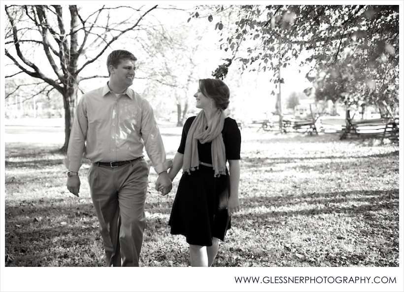Black and white photo of young couple walking in autumn in Old Salem