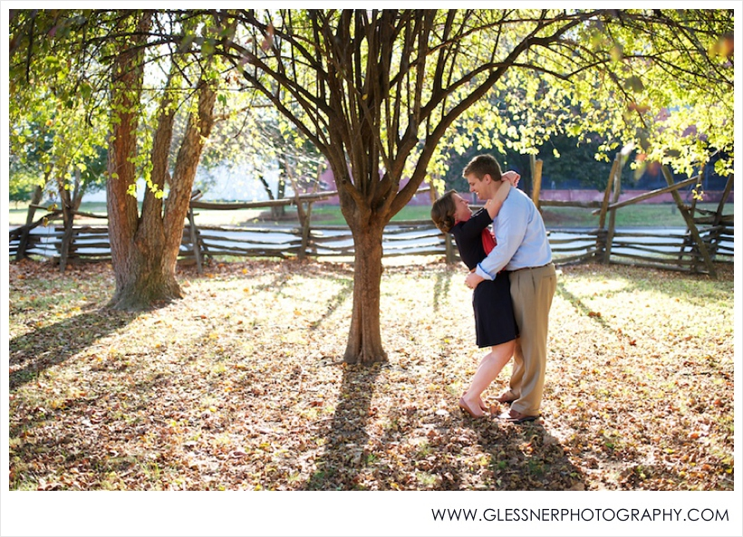 Couple embracing and laughing in autumn in Old Salem