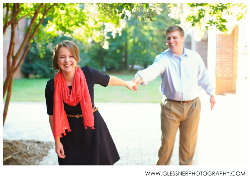 Couple laughing during engagement photos at Old Salem
