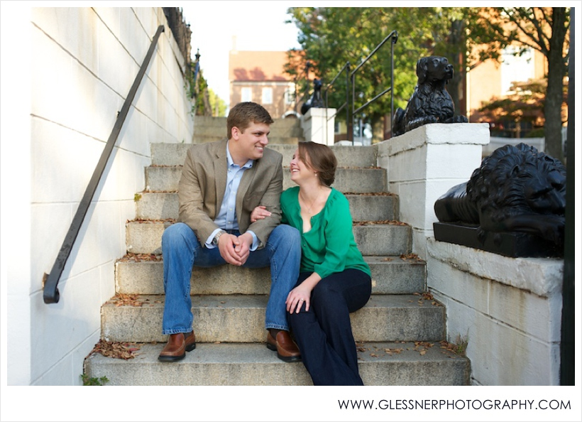 Engagement photo of couple laughing on steps in Old Salem