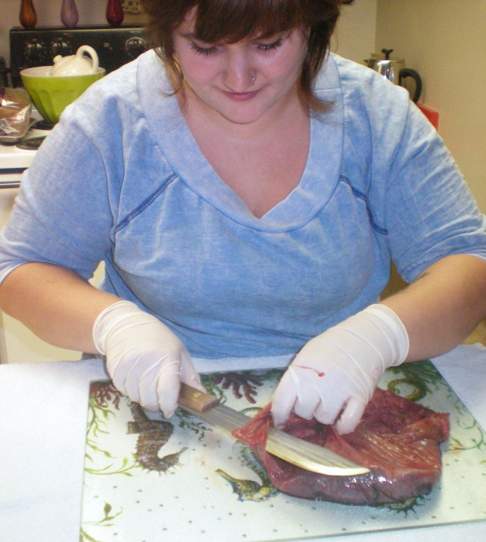 Megan removes the membranes and umbilical cord