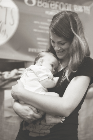 Homeborn baby Jaxon gets all the Mary Catherine Cuddles while his mama Melissa meets potential clients at the Natural Birth and Baby Expo this Spring
