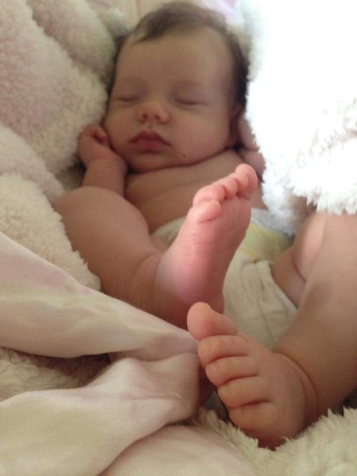 Baby Siena snoozing while her mom happily snaps pictures of these delicious little feet!