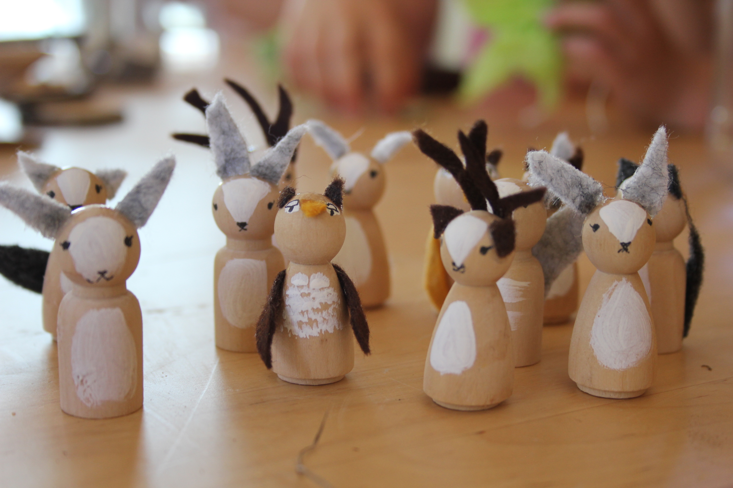 2. Invite some woodland friends. We found these wooden peg people at our local craft store. Add some faces, acrylic paint and felt ears, feathers or antlers.
