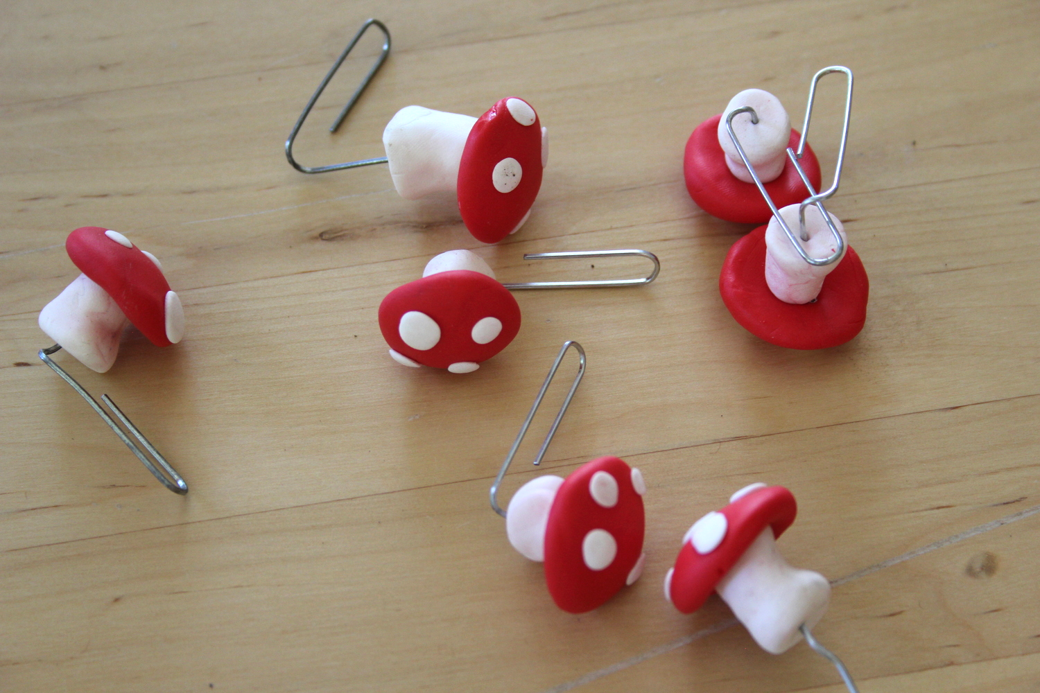 3. Gather mushrooms. Red and white Fimo red caps with a wire armature (paper clips).