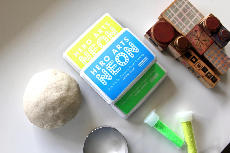 Make some salt dough. Gather supplies +some stamps + glitter + cookie cutter.