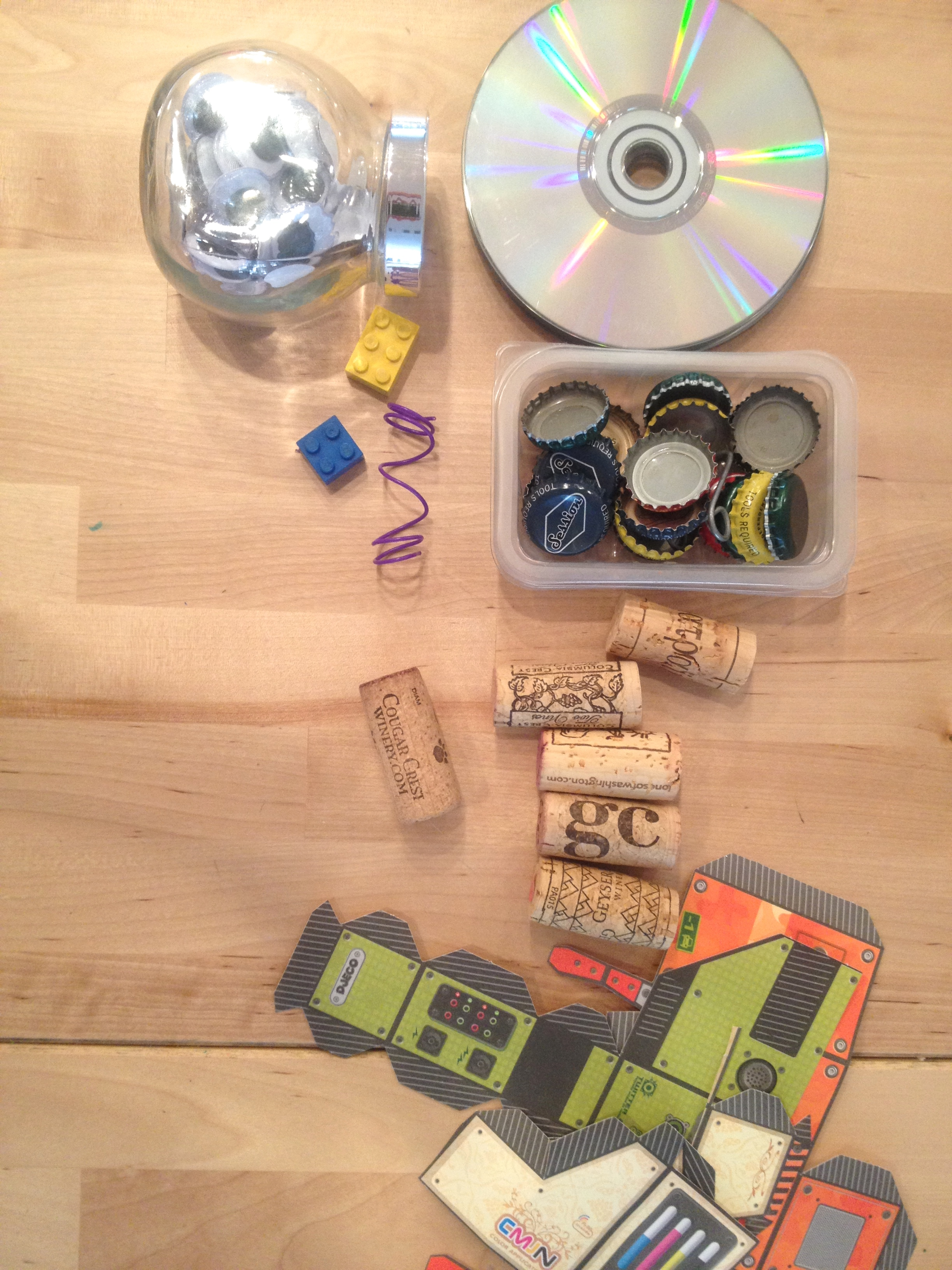 Wiggly eyes, old cds, odd and ends, bits and pieces can help bring your robot to life. Hot glue gun required? YES!!!