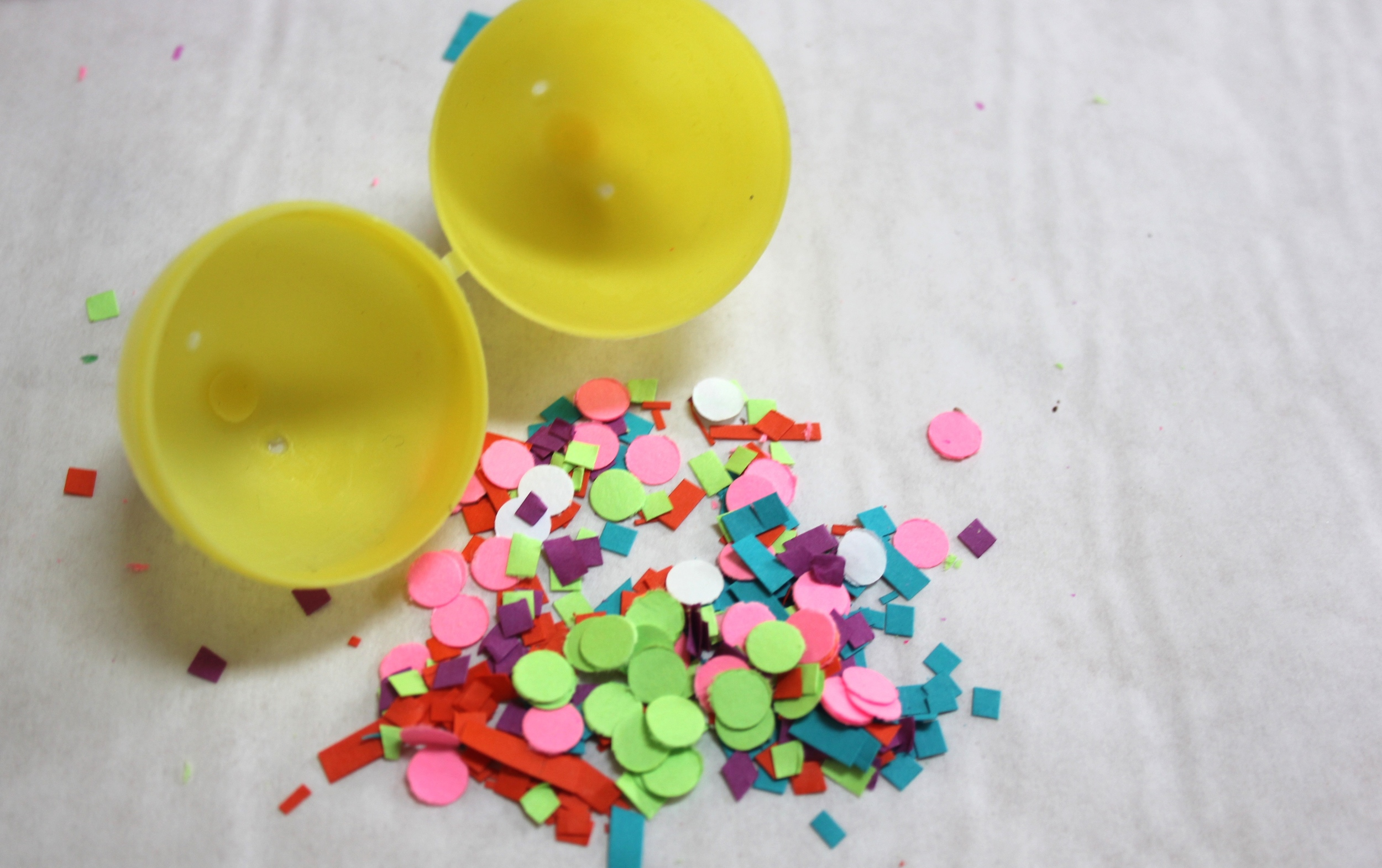 Fill leftover eggs with confetti made with a hole punch and scissors (those fringe scissors can make tiny square confetti too). Put the confetti in the egg and tape it closed.