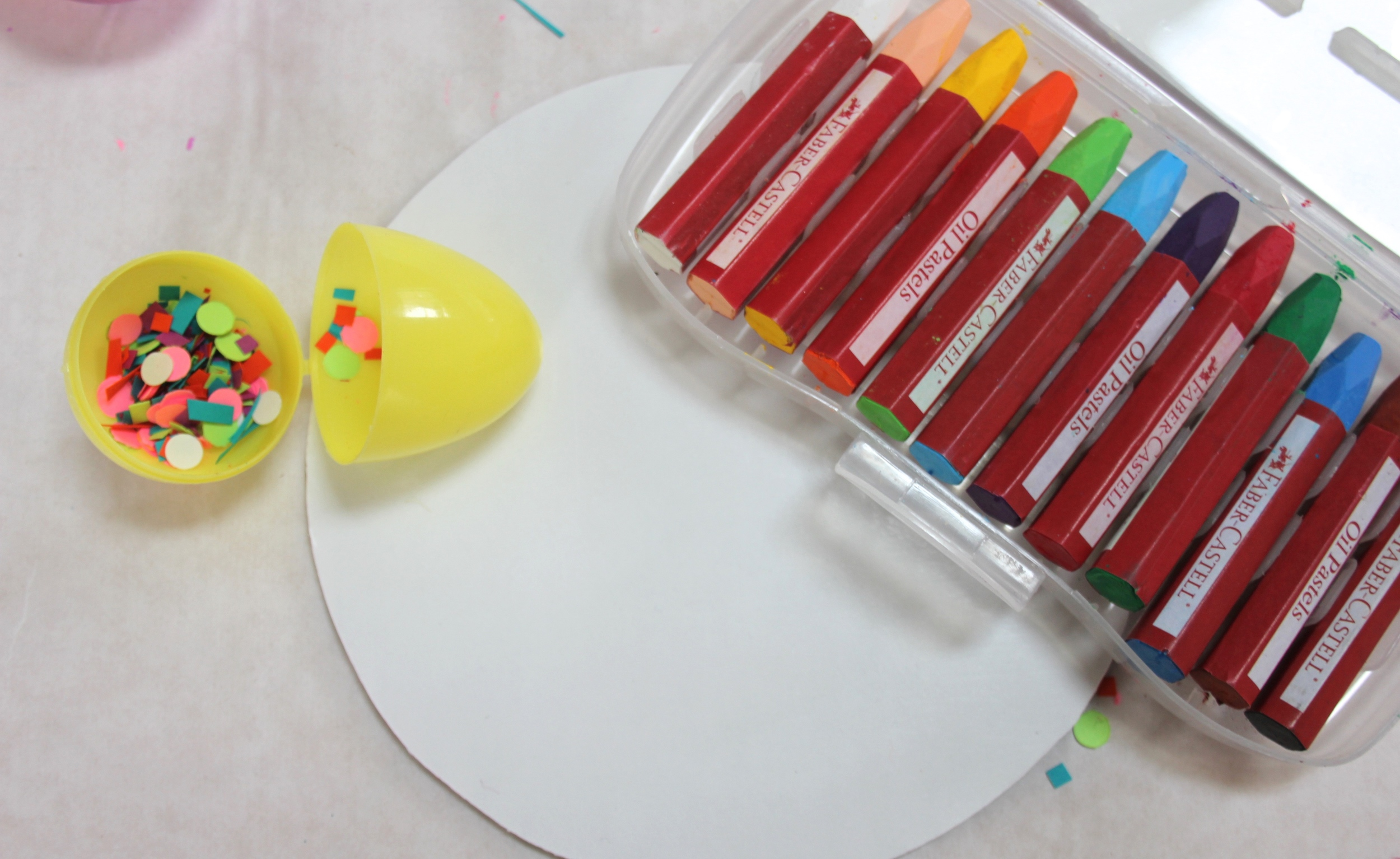 Cut a circle piece of paper. Draw to your heart's content using your favorite drawing tools.