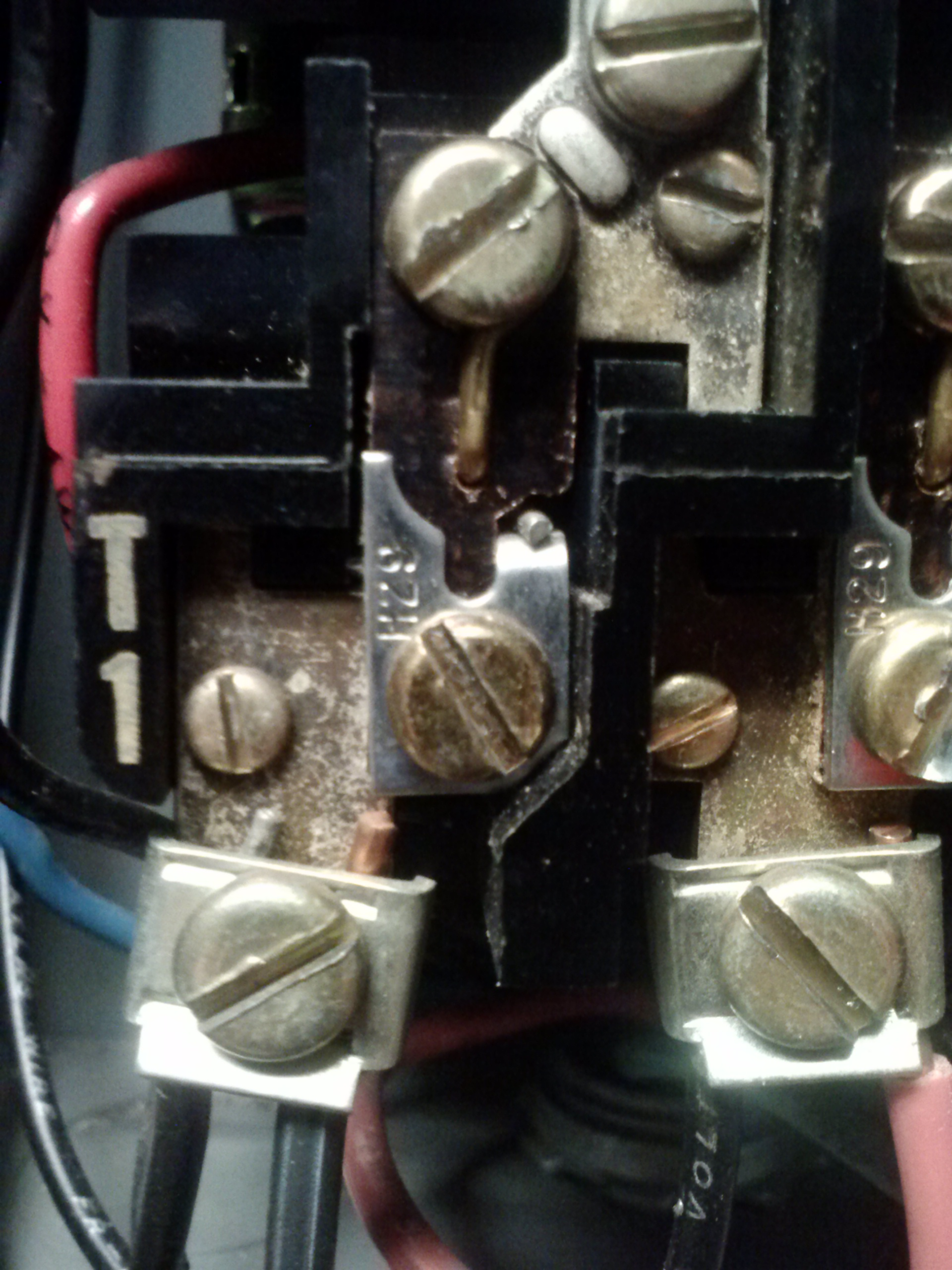 """Part III. This is the overload protection """"heater"""" on top of the motor starter. This heater is selected from a chart under the motor controller cover. You can see it is a called an H29."""
