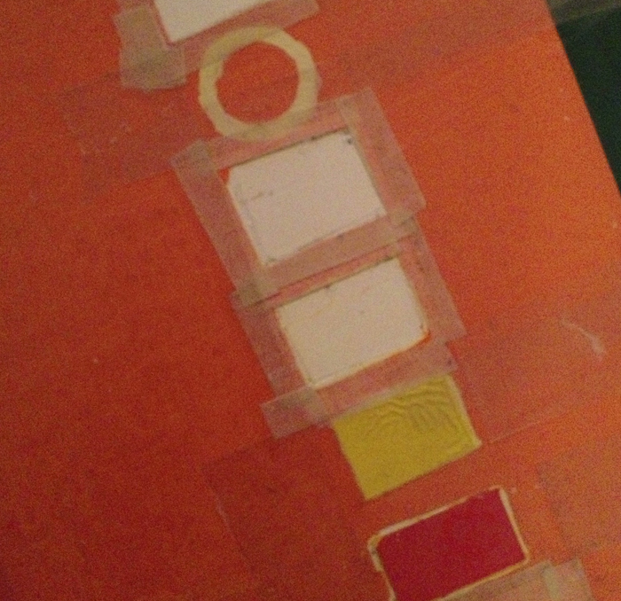 Masking the detail where the word 'contents' should be; I like the 'puckered' yellow paint!