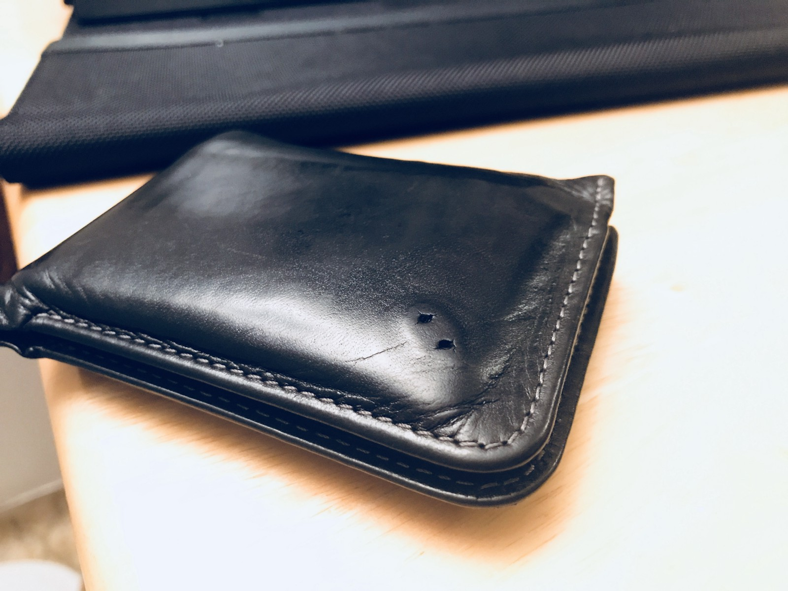 The wallet logo was missing. It's likely because it got caught in the pockets very often.