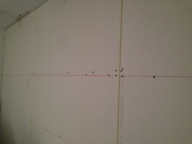 Two Layers of drywall up with green glue. The red lines are where the hat channels were. We missed a couple of times.