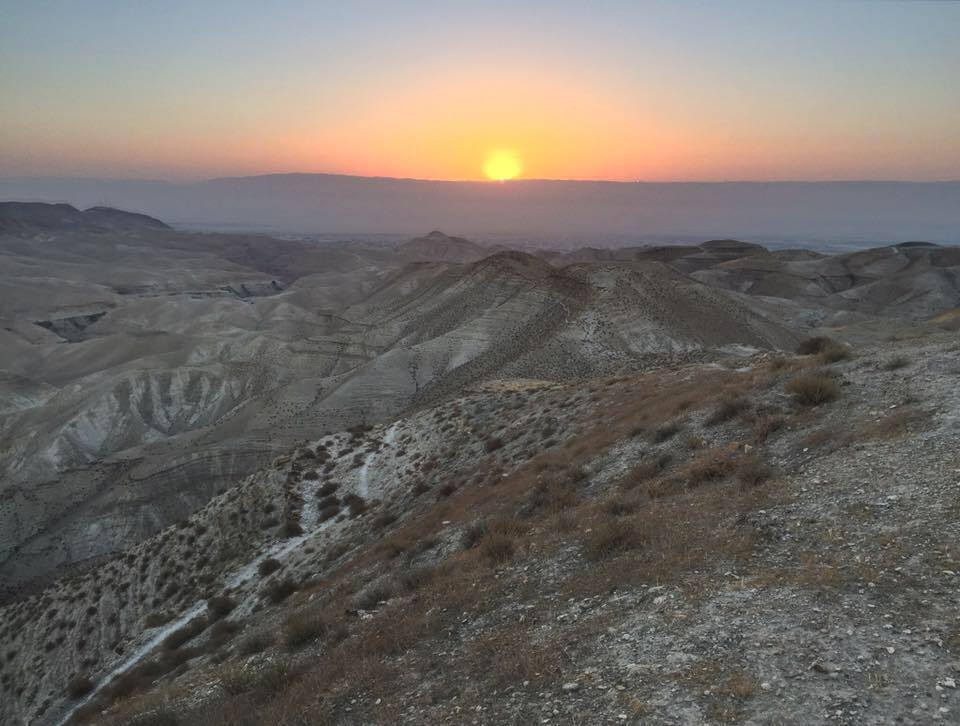 The Judean Desert at sunrise before the celebration of the Eucharist