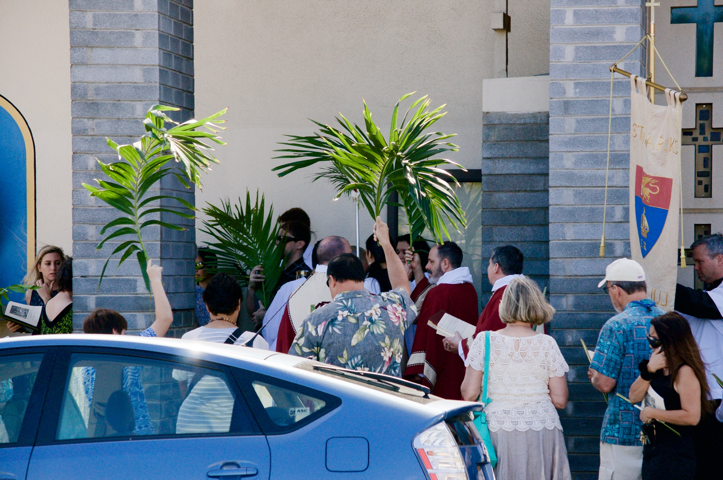 The Palm Sunday Procession reaches the front doors of the church.