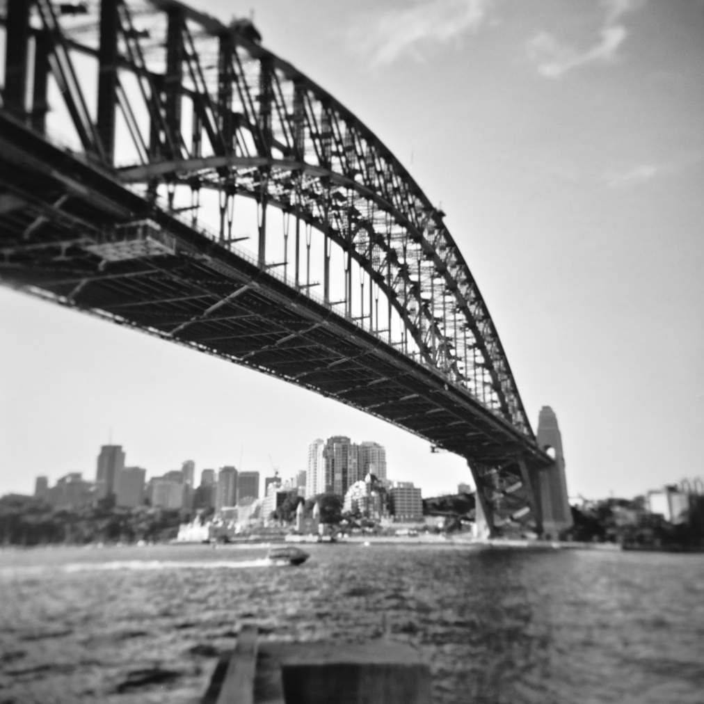 The Sydney Harbour Bridge with Luna Park in the distance. Photographed with a Holga.