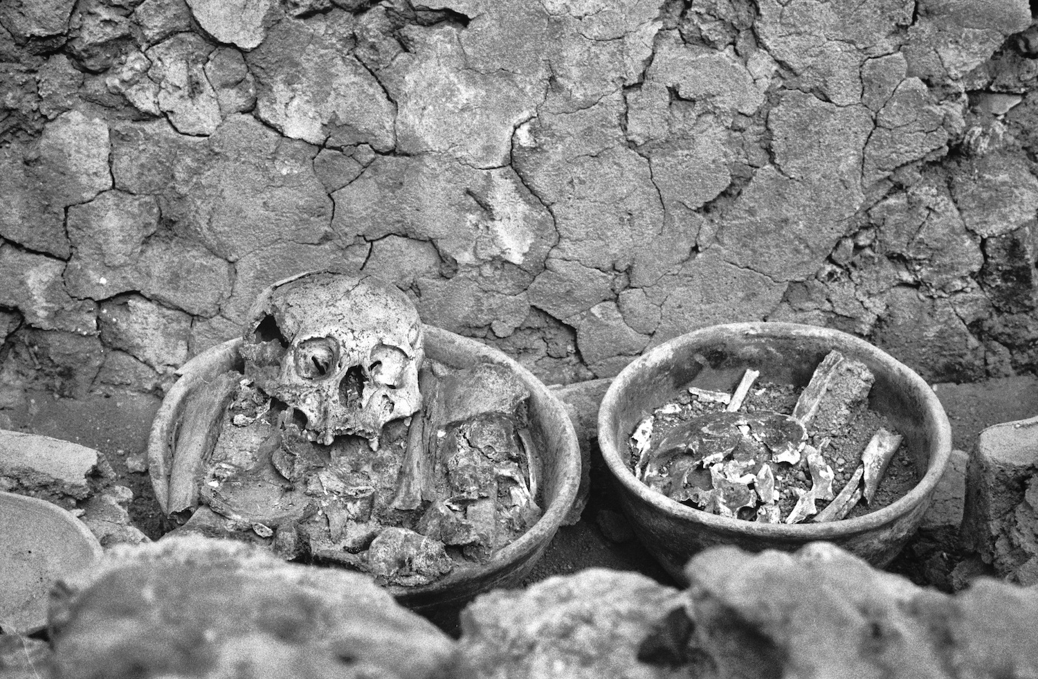 Remains of children deposited in ceramic pots at the Courtyard of Altars in the Great Pyramid of Cholula, Mexico. It's believed these children were messengers to Tlaloc, the Aztec god of rain, fertility and water. Photographed sometime in 1993.