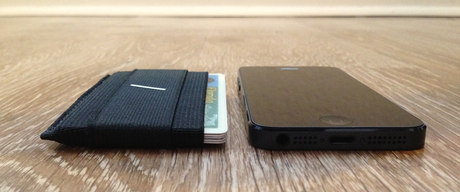 Snapback Slim Wallet 2.0 next to iPhone