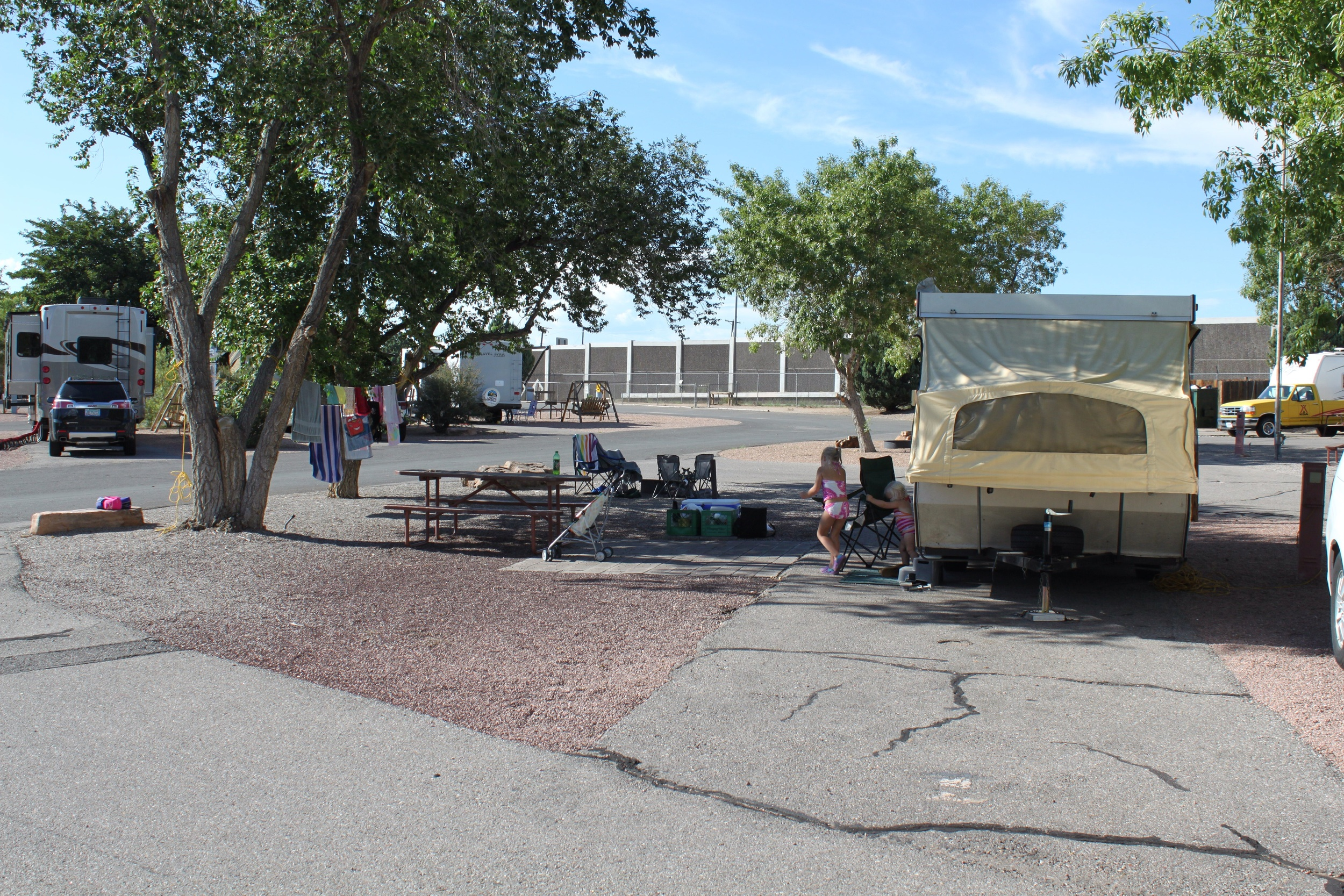 Our campsite in Albuquerque. That wall in the background separates us from the highway.