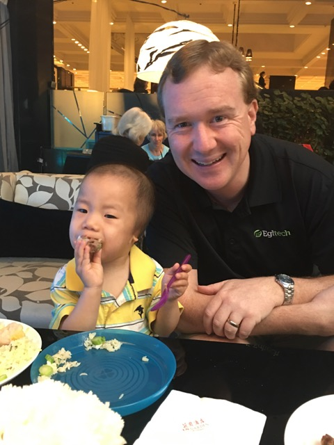 Joshua. With his dad and his food.