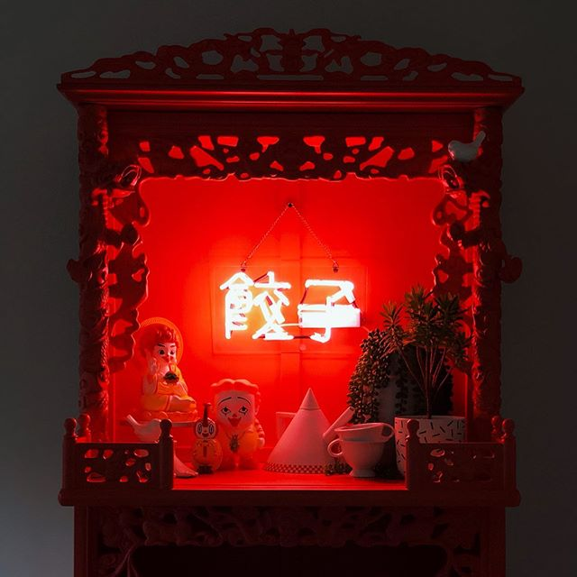 "In our kitchen we have this beautiful Chinese hutch my dad gave us a short while back. He knew we wouldn't want to keep it plain wood finished, and asked what color we wanted to custom paint it... and of course we requested fluorescent red! 😄 It is a tough color to photograph, but is amazing to see in person. Inside it holds some of our cookbook collection, Ronald McDonald themed vinyl art figures, and a neon sign that reads ""dumplings."" . . . . . #xanthic #xanthicasa #neonsigns #🥟 #ronaldmcdonald #tikafromeast #ronenglishtoys #redfurniture #notafraidofcolor #chinesehutch #portlandhomes #pdxdesign #interiorporn #interiordesire #howwedwell #sodomino #keepitweird"