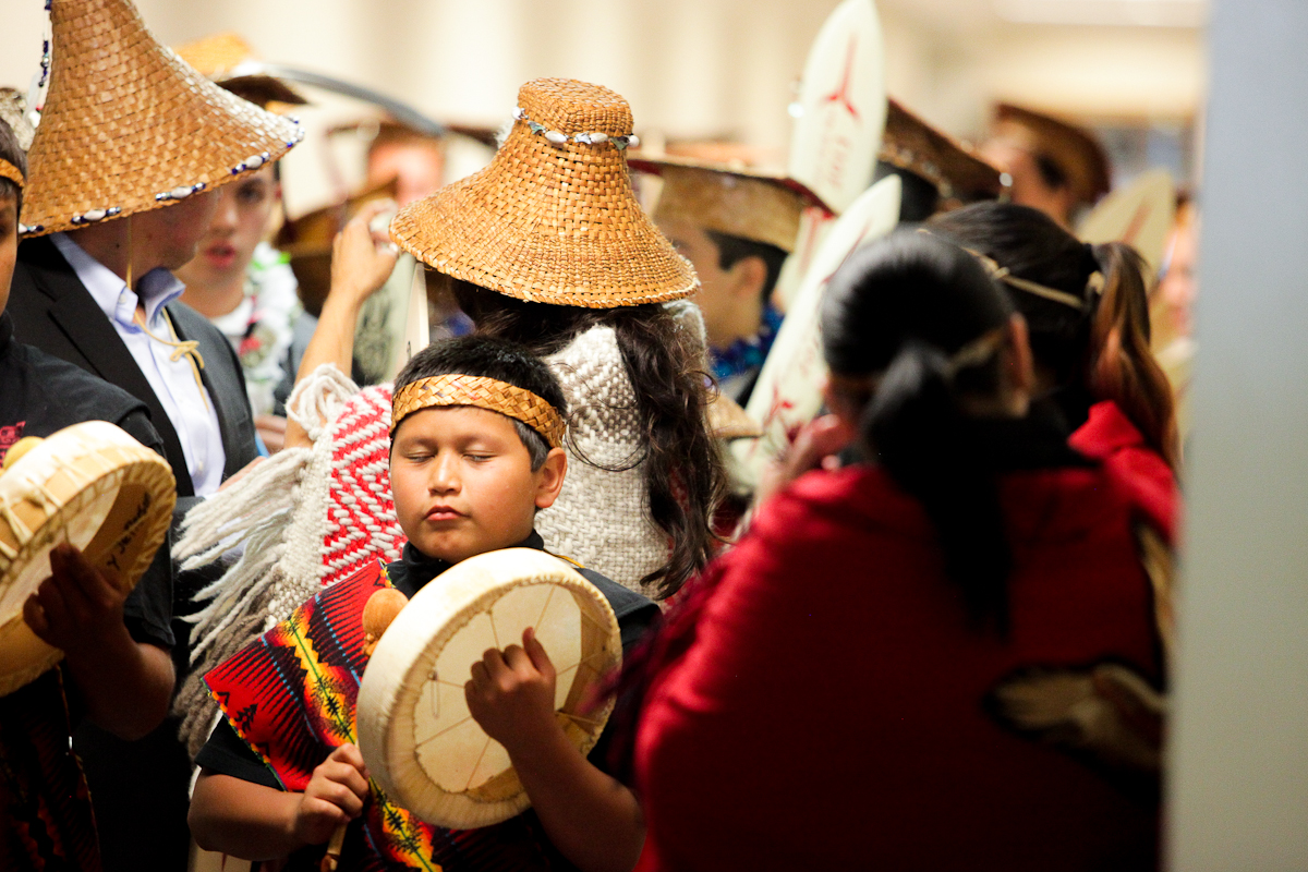 A young boy in processional leading the graduating seniors to the stage practices moments before the ceremony start.