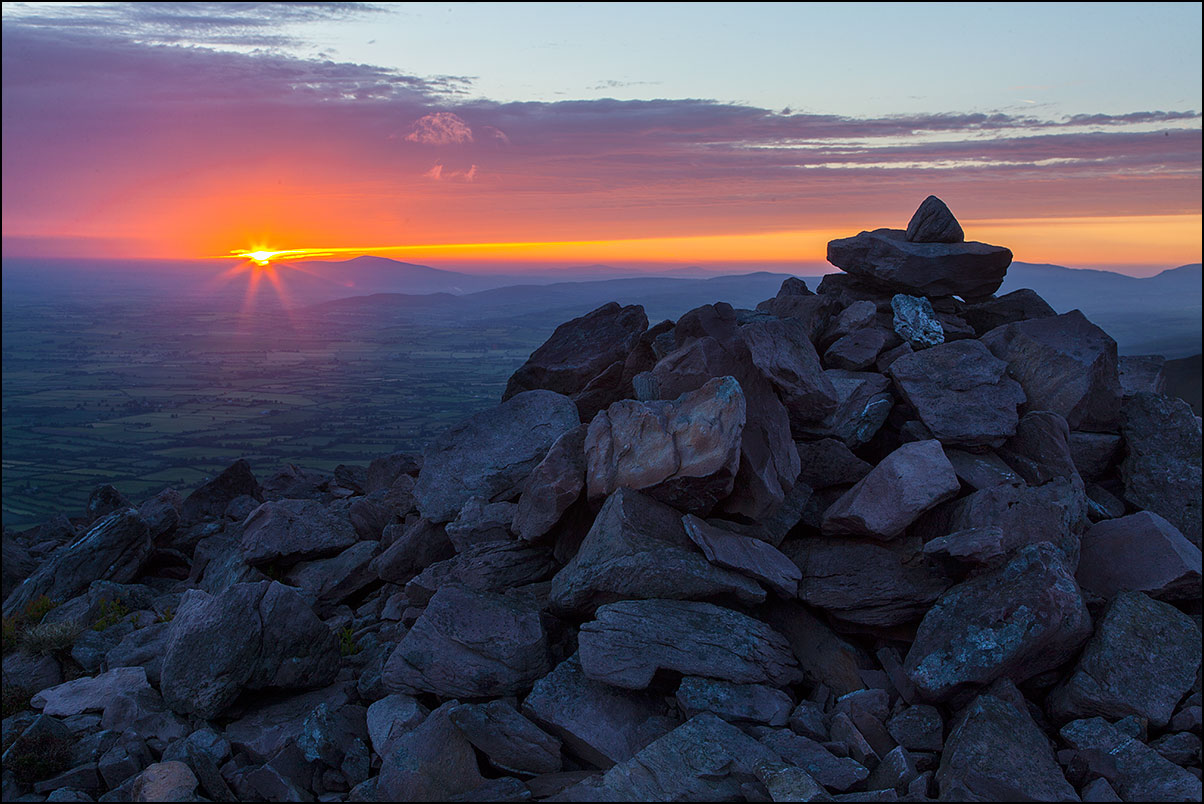 Sunrise over Slievenaman, photo by John Finn. This work is licensed under a  Creative Commons Attribution-NonCommercial-NoDerivs 2.0 Generic License  .
